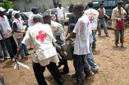 Conakry, Guinea. Personnel of the Red Cross Society of Guinea evacuate casualties during the September 2009 violence.