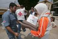 Lebanon. Lebanese Red Cross volunteers distribute ICRC hygiene kits and blankets to internally displaced persons.